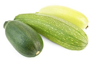 Two green zucchini varieties and one yellow isolated on a white background